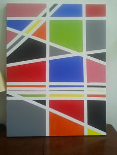 Easy geometric painted canvas with tape and complimentary colors.