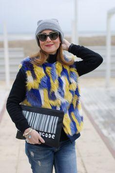 Moschino sunglasses, faux fur vest