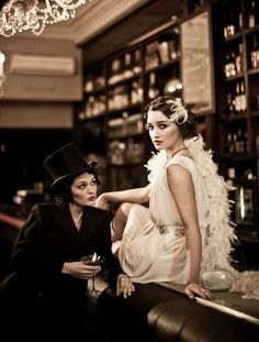 Great Gatsby fashion- with the right materials the simple white dress would be quite easy tom make I think, the feather boa and the head dress and pearls make it perfect for the time
