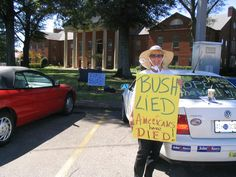 GW Bush, Worst President EVER. This protester of the Bush Administration is Kelly Jacobs, at the Hernando Courthouse in Mississippi.