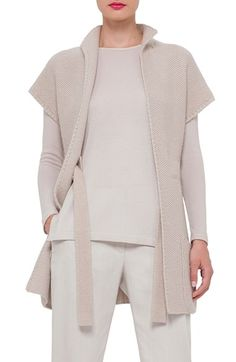 """Free shipping and returns on Akris Purl Stitch Cashmere & Silk Knit Vest at Nordstrom.com. <p><b style=""""COLOR:#990000"""">Pre-order this style from the Pre-Spring/Resort 2016 collection! Limited quantities. Ships as soon as available. You'll be charged only when your item ships.</b></p><br>Crafted from a luxe cashmere-silk knit in a muted neutral hue, this cap-sleeve sweater vest makes for a versatile layering piece. An interior drawstring tie belt cinches the loose silhouette to help define…"""