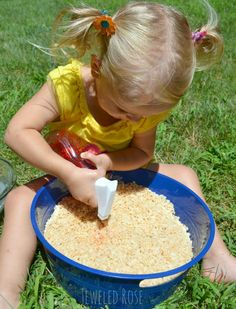 Paint popping rice.  A canvas with sound effect; TOO COOL!  This play time was so fun for Jewel and so simple.  You have probably figured out by now what we used to make this popping rice sensory playtime.  It's Rice Krispies- that's it!  A small box of cereal, a bowl of water, a spray bottle of colored water.....and TONS of fabulous fun and exploration!