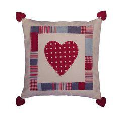 https://flic.kr/p/4UUJUu | Red polka-dot heart cushion | Large cushion with hand appliquied heart and patches.  Each corner has a red padded heart.  Envelope style back.