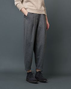 Very tapered, ankle-skimming, pleat-front trousers in a soft, slouchy wool blend flannel. Button fastening at right side. Two pockets. Buttoned and jetted back pocket.