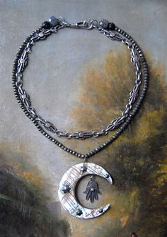 The centerpiece of this necklace is an antique huge mother of pearl moon. It was…