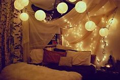 Chinese light balls over the bed.
