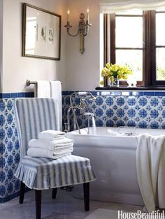 Joe Nye - The master bath in this Tuscan-Style home has Portuguese glazed blue and white tiles. A Pottery Barn side chair is slipcovered in a blue and white linen stripe from Rogers & Goffigon. Interior Simple, Interior Modern, Home Interior, Interior Design, Bathroom Interior, Modern Bathroom, Serene Bathroom, 1950s Bathroom, Colorful Bathroom