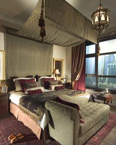 Fabric hung above bed (ceiling) held by curtain rods. Hang tassles at the end-of-the-bed side to give the effect of  four post bed — love!
