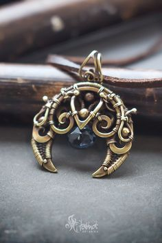 Cosmic necklace. 5th element alien necklace pendant Lunula. Wire wrapped raw brass crescent moon with blue quartz.