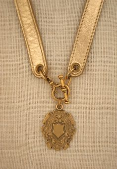 Leather Band Necklace in Gold. $239. Ex Voto Vintage. -via Interior Canvas (GIVEAWAY)!!!