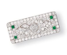 AN ART DECO DIAMOND AND EMERALD BROOCH, BY TIFFANY & CO.    Designed as a pierced panel, centering upon a diamond quatrefoil, within an openwork geometric diamond border, to a square-cut emerald at each corner, mounted in platinum, circa 1925, 4.2 cm wide    Signed Tiffany & Co.