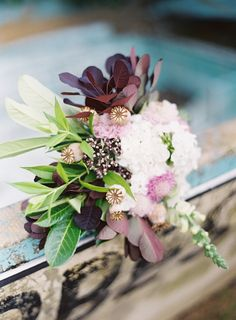 peaceful seaside wedding inspiration purple bridal bouquet