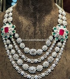 The four layered bridal necklace with innumerable number of brilliant diamonds adorned with ruby and emerald studded floral side pendants. Mango Mala Jewellery, Indian Jewelry Earrings, Bridal Jewelry, India Jewelry, Ruby And Diamond Necklace, Emerald Necklace, Mango Necklace, Emerald Diamond, Gold Jewellery Design