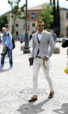 Shop this look on Lookastic:  http://lookastic.com/men/looks/sunglasses-dress-shirt-waistcoat-blazer-belt-zip-pouch-skinny-jeans-tassel-loafers/10096  — Dark Brown Sunglasses  — White Dress Shirt  — Black Waistcoat  — Black and White Gingham Blazer  — Black Leather Belt  — Dark Brown Plaid Leather Zip Pouch  — White Skinny Jeans  — Dark Brown Leather Tassel Loafers