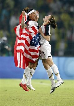 The United States' Natasha Kai, left, and Heather O'Reilly celebrate after beating Brazil 1-0 in the women's soccer gold medal match - Beijing Olympics 2008