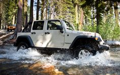 2012 Custom Jeep Wranglers Unlimited | 2012 Jeep Wrangler Unlimited Side View In Water