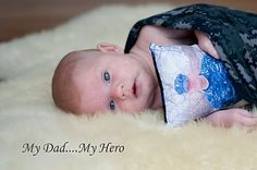 Print a picture of loved ones on a pillow, so baby will recognize their face when he/she comes home.