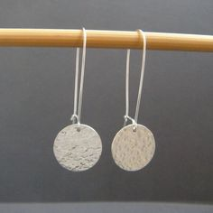 hammered circle earrings. sterling silver. long dangle. modern drop earrings. discs. simple minimalist. contemporary. kidney wire. gift 5/8    - Created by me, these solid sterling silver circles are each 5/8 (16 mm) across. Circle discs are a nice 22 gauge, so they feel solid yet are still lightweight.  - Length is 1 7/8 (4.7 cm) from the top of the kidney wire to the bottom of the dangling circle.  - Ive hammered the front of each disc, polished them smooth on the back. Tumbled for a great…