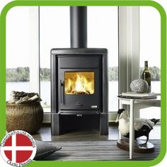 The new Oden 6300 cast iron woodstoves from Josef Davidssons.  This is the 6300 convection stove with black soapstone.