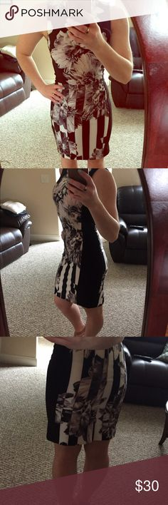 """NWT H&M Illusion Dress H&M black and white illusion dress. Black panels on side create slimming effect. Zipper in back. High neckline, slit in center back. Made well-Super flattering, I love this dress it just runs a little small for me 😭 (I'm usually size 6, 34"""" bust) Never worn, NWT. Size 6 ❗️runs small. H&M Dresses Midi"""