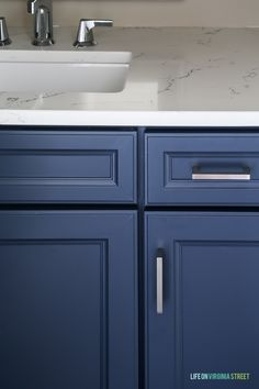 Powder bathroom cabinets freshly painted in a cool navy blue, Delta Faucet faucet, Behr Castle Path Walls and Benjamin Moore Hale Navy Cabinets. Love the fresh, nautical vibe! Countertops are Daltile One Quartz in the Luminesce color. Navy Blue Bathrooms, Navy Bathroom, Bathroom Paint Colors, Small Bathroom, Bathroom Ideas, Bathroom Vanities, Painted Cabinets In Bathroom, Master Bathroom, Bathroom Hacks