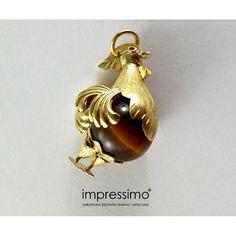 Medalion wenecki w formie koguta, wykonany ze złota 18K, zdobiony tygrysim okiem. Praca autorska z II połowy XX wieku, waga 10,6 g, wysokość: 3 cm.  Venetian medallion in the form of a rooster, made of 18K gold, decorated with tiger's eye. Author's work from the second half of the twentieth century, weight 10.6 g Height: 3 cm.  http://impressimo.pl/wisiorki-i-medaliony/327-medalion-wenecki-w-formie-koguta-ea-5879.html