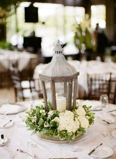 Lantern centerpiece with or without flowers that will provide a romantic ambiance for your guest tables.