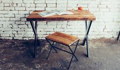 Built to carry the freight, The Lewis' sturdy design adds a solid emphasis to any space. Handmade with flat black iron legs and one of a kind salvaged wood.