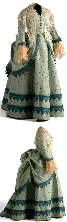 Dress, circa with fitted, boned bodice, and skirt open in front forming a bustle in back. Lace fichu with hexagonal tulle background and floral embroidery via Museo del Traje. The colors combo is one of my favorite parts about this piece! Victorian Era Fashion, 1870s Fashion, Vintage Fashion, Antique Clothing, Historical Clothing, Vintage Gowns, Vintage Outfits, Bustle Dress, 19th Century Fashion