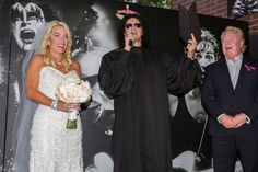 """""""You may now Kiss the bride."""" Gene """"Dr. Love"""" Simmons officiates his first wedding as Lee Samango and Michael Gottlieb tie the knot at Rock & Brews restaurant on May 10, 2014 in El Segundo, Calif."""