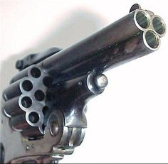Belgian made Revolver...holds 18 rounds.....fires 3 at a time.....no need to double tap them zombies
