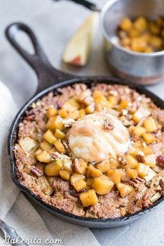 This Apple Cinnamon Skillet Cookie is a deep-dish spiced cookie that's loaded with fresh diced apples and warm fall spices! This gluten-free, refined sugar-free, and Paleo-friendly skillet cookie is topped with caramelized apples.