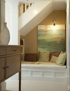 reading nook under the stairs, I like the shelves. Add a curtain that pulls back!