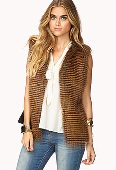 Faux fur is the only fur for fall 13... And we love it. Luxe Faux Fur Vest | FOREVER21 - 2079502083