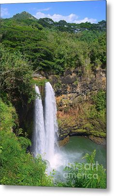 """#Wailua Falls in #Kauai. #WailuaFalls is an 113-foot waterfall located in Kauai, #Hawaii.   In ancient times, Hawaiian men would jump from the top of the falls to prove their manhood. And people still leap off, though it is dangerous and illegal. There is another waterfall nearby named 'Opaeka'a Falls.  The Falls were featured on the opening credits of the television show """"Fantasy Island."""" http://fineartamerica.com/featured/wailua-falls-in-kauai-catherine-sherman.html"""