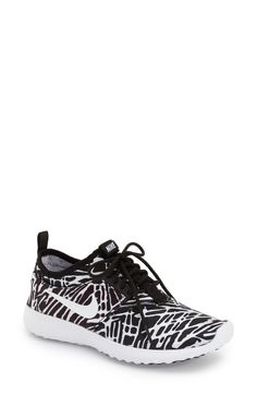 Swooning over this chic black and white Nike sneaker that will pair perfectly with black leggings and a zip up.