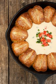 A great party idea! This warm, salty skillet pretzel rolls and cheese dip recipe can be made ahead and re-heated for the event. With Mexican cheese dip.