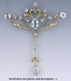 STUNNING c1900-1915 EDWARDIAN 15ct GOLD AQUAMARINE & SEED PEARL PIN/BROOCH  Presented is an elegant Edwardian aquamarine and pearl brooch/pin. This piece dates to around 1900-1915, and is of English origin. The brooch is made in a design like draped ribbons, set with natural seed pearls. The brooch is set with 9 aquamarines of varying sizes and cuts, for a total weight of about 5.8 carats . This piece is lovely as a pin but could easy be converted into an attractive pendant. | eBay  $900