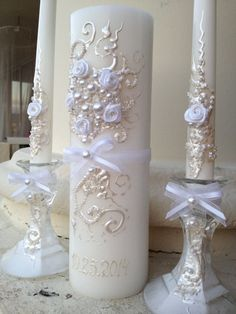 Unique and elegant Wedding Unity Candle set, hand decorated with fabric roses, bows and pearls. Colors are Mother of pearl and white. Gel Candles, Pillar Candles, Wedding Crafts, Wedding Decorations, Wine Glass Crafts, Inexpensive Wedding Favors, Wedding Unity Candles, Luxury Candles, Wedding Glasses