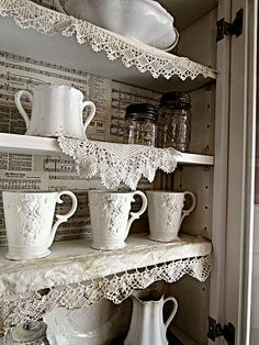 Love the sheet music lining the shelves for this Cozy Kitchen!