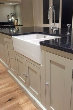 Cream handmade kitchen with large island and black worktops kitchen worktop Black And Cream Kitchen, Cream Kitchen Units, Cream Kitchen Cabinets, Kitchen Cabinet Styles, Black Cream, Kitchen Corner Cupboard, Teal Kitchen, Kitchen Handles, Kitchen Appliances