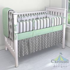 Crib bedding in White and Gray Elephants, White and Gray Stripe, Solid Mint Minky, Gray and White Polka Dot. Created using the Nursery Designer® by Carousel Designs where you mix and match from hundreds of fabrics to create your own unique baby bedding. #carouseldesigns