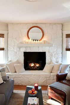 We painted our stone fireplace white and how many candles is too many? #paintedstone #paintedbrick #fireplace #paintedbbrickfireplace #paintedstonefireplace #whitefireplace #cloudwhite #candles #mirror White Stone Fireplaces, Painted Stone Fireplace, Stone Fireplace Makeover, Slate Fireplace, Candles In Fireplace, Bedroom Fireplace, Home Fireplace, Fireplace Remodel, Fireplace Design