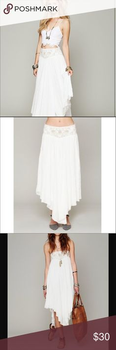 Free People festival maxi convertible skirt:dress High low maxi skirt, maybe worn as a dress. Embroidered detail on the waist. Flowy.  Previously owned.  Please note there are some very small stains at the bottom of the dress, not  noticeable when wearing it - see last picture Free People Dresses High Low