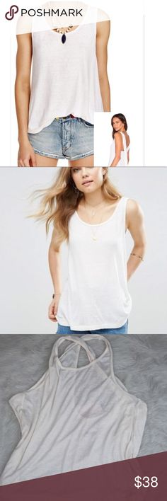 🎉BOGO 🆓🎉NWT Free People Break of Dawn Top Super cute, lightweight tank by Free People with criss cross shoulder straps.  Jersey knit fabric.  50% polyester, 37% cotton, 13% rayon.  Color: Ivory. Free People Tops Tank Tops