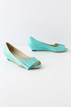 Start a colorblocked ensemble from the ground up with these brightly bowed, patent leather flats by Butter.$258  Fits true to size