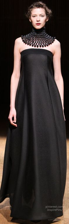 Fall 2014 Ready-to-Wear Josie Natori--Heidi Klum...she wears odd necklines w/ gowns...this one, I actually like...I'd have it tailored to not be as full...or even make into a pant suit !!!