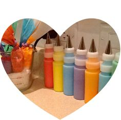 Piping Bags and Decorating Bottles of Royal Icing in Various Colours