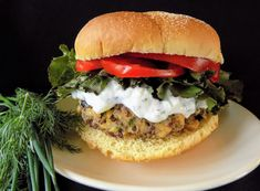 Flavor-packed burgers with homemade tzatziki topping #FatFridaysForever