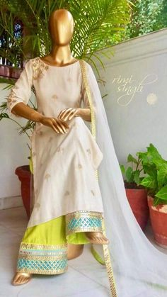 Grace changes everything. Off white banarasi chanderi kurta with gota work around the neck and sleeves, teamed with parrot green loose pants with gota work around the paucha and a pure organza dupatta with gota patti on the sides Pakistani Dresses, Indian Dresses, Indian Outfits, Indian Attire, Indian Ethnic Wear, India Fashion, Ethnic Fashion, Kurta Designs, Blouse Designs